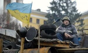 Un homme sur une barricade sur la place Maidan de Kiev en février 2014 (Photo : SIPA.00677109_000018)