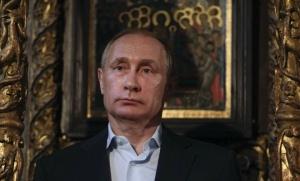 Vladimir Poutine en visite au Protaton, l'église grecque orthodoxe de Karyès, le 28 mai dernier. (Sipa: SIPA_ap21902113_000005)