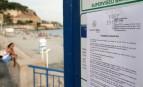 L'arrêté municipal de la Ville de Nice affiché à l'entrée d'une plage de la promenade des Anglais (Photo : AFPArchives JEAN CHRISTOPHE MAGNENET)
