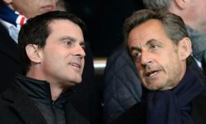 Manuel Valls et Nicolas Sarkozy au Parc des Princes à Paris, mars 2014. SIPA. 00677712_000056