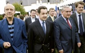 Alain Juppé, Nicolas Sarkozy, Jean-Pierre Raffarin et François Baroin au Conseil national élargi de l'UMP à Le Coudray-Montceaux, juin 2004.