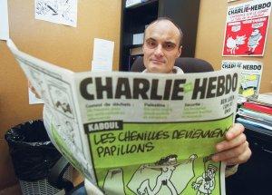 Photo prise le 22 novembre 2001 à Paris du rédacteur en chef du journal Charlie Hebdo, Philippe Val. Photo : FRANCOIS GUILLOT / AFP)
